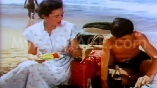 Mom and her son having picnic at the beach