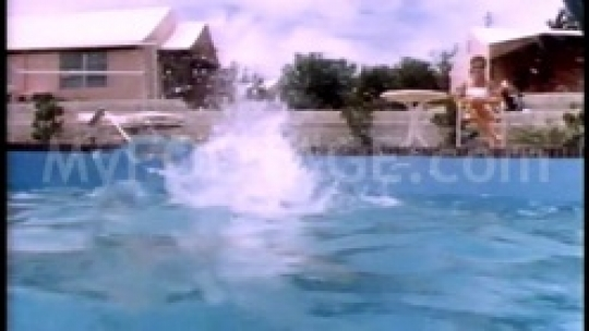 Woman diving into a pool in slow motion